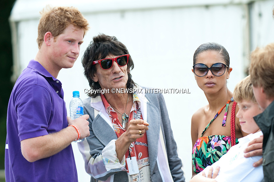 "Prince Harry.Chats with Ronny Wood and Kenny Jones after playing in 2010 Asprey World Class Cup Polo, played at Kenny Jones'Hurtwood Park, Surrey_England_17/07/2010..Mandatory Photo Credit: ©Dias/Newspix International..**ALL FEES PAYABLE TO: ""NEWSPIX INTERNATIONAL""**..PHOTO CREDIT MANDATORY!!: NEWSPIX INTERNATIONAL(Failure to credit will incur a surcharge of 100% of reproduction fees)..IMMEDIATE CONFIRMATION OF USAGE REQUIRED:.Newspix International, 31 Chinnery Hill, Bishop's Stortford, ENGLAND CM23 3PS.Tel:+441279 324672  ; Fax: +441279656877.Mobile:  0777568 1153.e-mail: info@newspixinternational.co.uk"