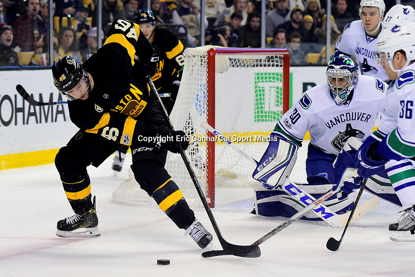 February 11, 2017: Boston Bruins center David Krejci (46) fights for the puck in front of Vancouver Canucks goalie Ryan Miller (30) during the National Hockey League game between the Vancouver Canucks and the Boston Bruins held at TD Garden, in Boston, Mass. Boston defeats Vancouver 4-3 in regulation time. Eric Canha/CSM