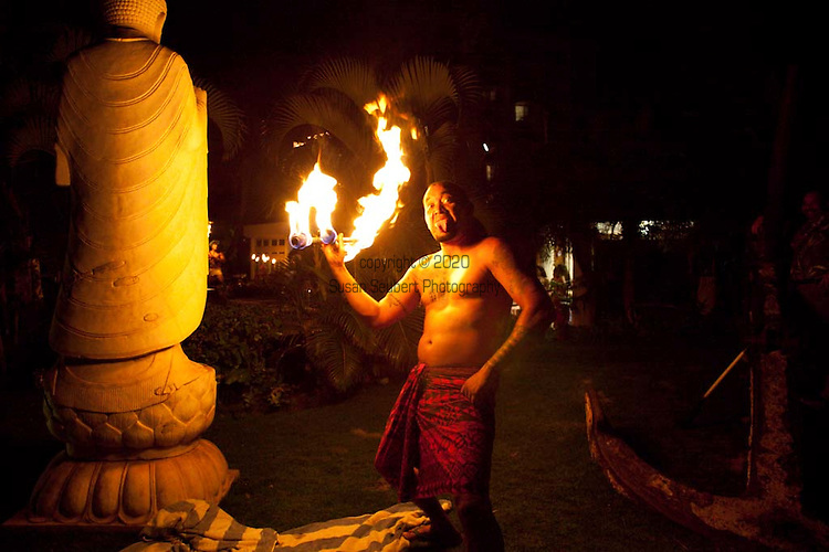 One of the fire dancing performers at the Wailele Polynesian Luaua at the Aloha Pavilion of the Westin Resort and Spa poses for a photograph.
