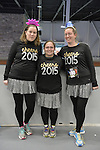 "East Meadow, New York, USA. December 31, 2014. L-R, HEATHER SOFTY of Bethpage, friend CHRISTINA PIETRAS, of Westbury, and sister LAURA SOFTY, of Bethpage, are wearing race bib identification and sparkly black shirts that say ""cheers 2015"" before participating in a 5K New Year's Eve DASH to support the Long Island Council on Alcoholism and Drug Dependence (LICADD) at the Twin RInks Ice Center at Eisenhower Park in Long Island. The Softy sister are members of Greater Longg Island Running Club (GLIRC). A Skatin' New Year's Eve event started hours earlier and a New Year's Eve Party, open to runners, family and friends continued until 2:30 a.m."