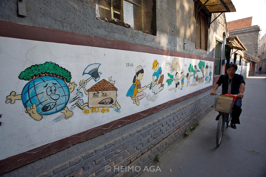 Traditional Sanjing Hutong (old quarter). Educational wall paintings. Propaganda to protect the environment.