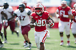 Wisconsin Badgers running back James White (20) scores on a touchdown run during an NCAA football game against the UMass Minutemen Saturday, August 31, 2013, in Madison, Wis. (Photo by David Stluka)