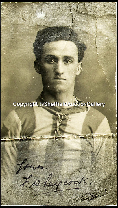 BNPS.co.uk (01202 558833)Pic: SheffieldAuctionGallery/BNPSSigned card of Freddie in his Sheffield Wednesday kit in 1923.<br /> <br /> The story of the first ever transfer deadline day scandal can be told after a 1920s journeyman footballer's personal affairs were unearthed.<br /> <br /> Fred Laycock played for 12 clubs in his 16 year career but it was his contentious move from Barrow to rivals Nelson on March 16, 1925 which sparked a furore.<br /> <br /> Laycock had enjoyed a stellar season at Football League Third Division North side Barrow, scoring 10 goals in 31 league matches.<br /> <br /> However, the club were paying him a paltry £4 -  £120 in today's money - so he had to top up his wages by working in a local shipyard.