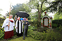 29/05/14 <br /> <br /> Coffin Well.<br /> <br /> Well-Dressing boards are blessed following church service.<br /> <br /> Wooden boards coated in clay are decorated with tens of thousands of petals, leaves and pieces of foliage to create giant intricate mosaics. The boards, that each take teams of ten villages three days to make are part of the Well Dressing displays in Tissington, Derbyshire. <br /> <br /> The village has been decorating its six wells every year for more than six hundred years. The tradition is believed to be a celebration of the wells never running dry, giving life and  sustaining the village during times of plague. After a church service today (Thursday)  clergy from six parish will bless each of the well.  <br /> <br /> Following in Tissington's footsteps many other villages in the Derbyshire area also have their own well dressing traditions.<br /> <br /> All Rights Reserved - F Stop Press.  www.fstoppress.com. Tel: +44 (0)1335 300098