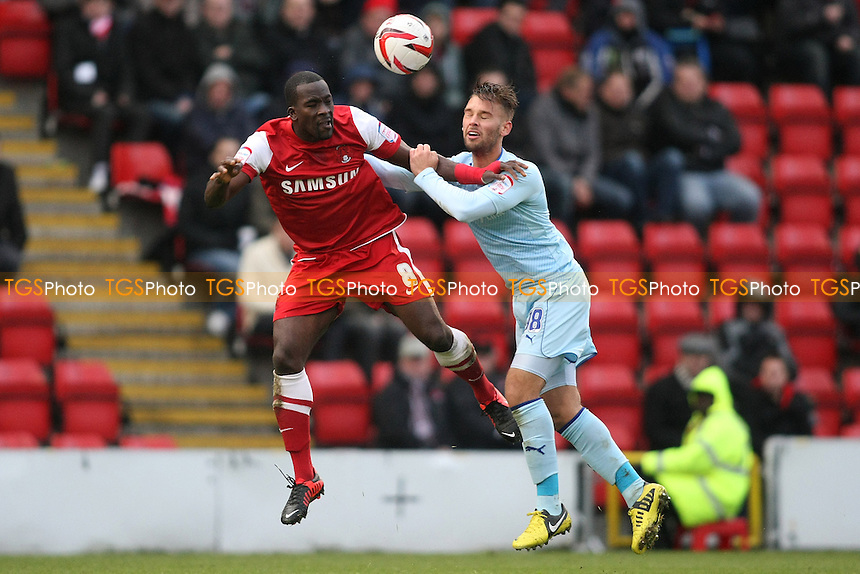 Anthony Griffith of Leyton Orient clears from James Bailey of Coventy City- Leyton Orient vs Coventry City - NPower League One Football at the Matchroom Stadium, Brisbane Road, London - 27/10/12 - MANDATORY CREDIT: George Phillipou/TGSPHOTO - Self billing applies where appropriate - 0845 094 6026 - contact@tgsphoto.co.uk - NO UNPAID USE.