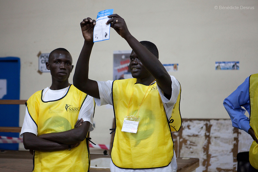 A poll worker show a Separation paper. Poll workers count the votes after the closing of a polling station in Juba, South Sudan. South Sudan's polling centres closed their doors on Saturday after a week-long vote on independence from the north that could end a vicious cycle of civil war with the creation of the world's newest state. Photo credit: Benedicte Desrus