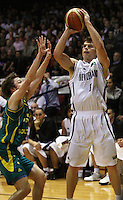 Tall Blacks captain Kirk Penney puts a shot up past Matthew Dellavudova during the International basketball match between the NZ Tall Blacks and Australian Boomers at TSB Bank Arena, Wellington, New Zealand on 25 August 2009. Photo: Dave Lintott / lintottphoto.co.nz