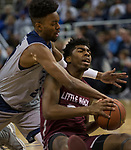 Nevada forward Jordan Brown, left, and Little Rock forward  Kamani Johnson scramble after a loose ball in the first half of an NCAA college basketball game in Reno, Nev., Friday, Nov. 16, 2018. (AP Photo/Tom R. Smedes)