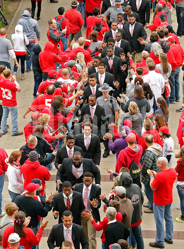 Ohio State Buckeyes football team walk into the stadium for their game against Kent State Golden Flashes in Ohio Stadium on September 13, 2014.  (Dispatch photo by Kyle Robertson)