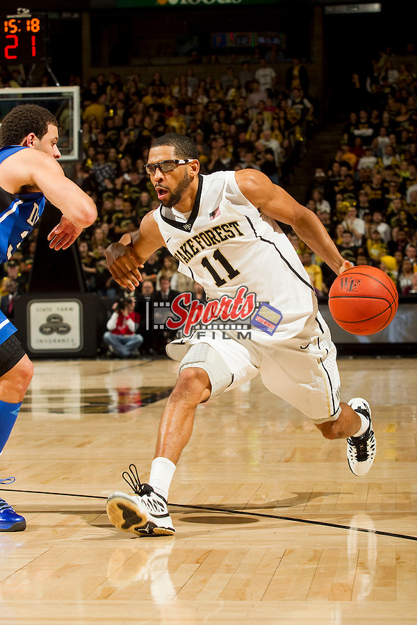 C.J. Harris (11) of the Wake Forest Demon Deacons drives past Seth Curry (30) of the Duke Blue Devils during second half action at the LJVM Coliseum on January 30, 2013 in Winston-Salem, North Carolina.  The Blue Devils defeated the Demon Deacons 75-70.  (Brian Westerholt/Sports On Film)
