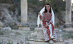 A Palestinian woman wearing traditional dress creation takes part during a Sebastya ninth Festival of Tourism and Heritage, in the West Bank city of Nablus, on September 12, 2018. Photo by Shadi Jarar'ah