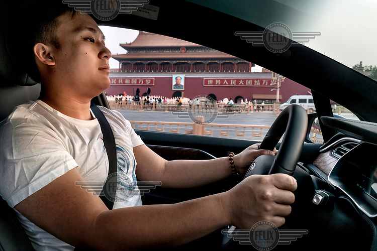 Mike (Fan Wenbo) drives his Tesla Model X past The Gate of Heavenly Peace in Tiananmen Square.