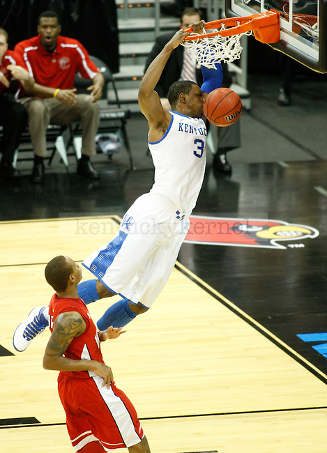 UK forward Terrence Jones slam dunks the ball during the first half of the UK vs. WKU NCAA second round game at the KFC Yum! Center March 15, 2012. Photo by Brandon Goodwin | Staff