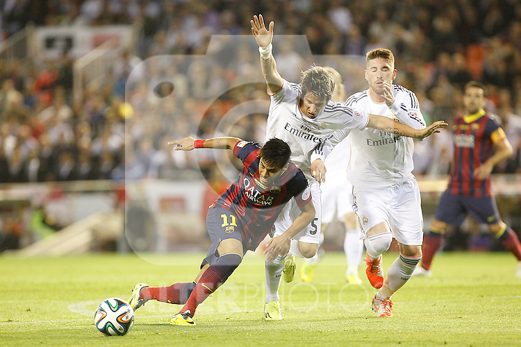 Real Madrid´s Coentrao and Sergio Ramos and F.C. Barcelona´s Neymar Jr during the Spanish Copa del Rey `King´s Cup´ final soccer match between Real Madrid and F.C. Barcelona at Mestalla stadium, in Valencia, Spain. April 16, 2014. (ALTERPHOTOS/Victor Blanco)