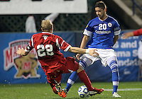 HOOVER, AL - DECEMBER 07, 2012:  Caleb Konstanski (22) of the University of Indiana tackles Christian Blandon (20) of Creighton University during an NCAA 2012 Men's College Cup semi-final match, at Regions Park, in Hoover , AL, on Friday, December 07, 2012. Indiana won 1-0.