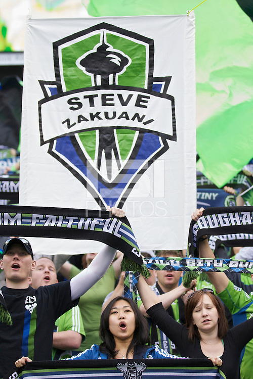Seattle Sounders FC fans cheer before play between the Seattle Sounders FC and Toronto at Qwest Field in Seattle Saturday April 30, 2011. In the background is a banner showing support for Seattle Sounders FC midfielder Steve Zakuani, who broke is leg in a previous game. The Sounders won the game 3-0.