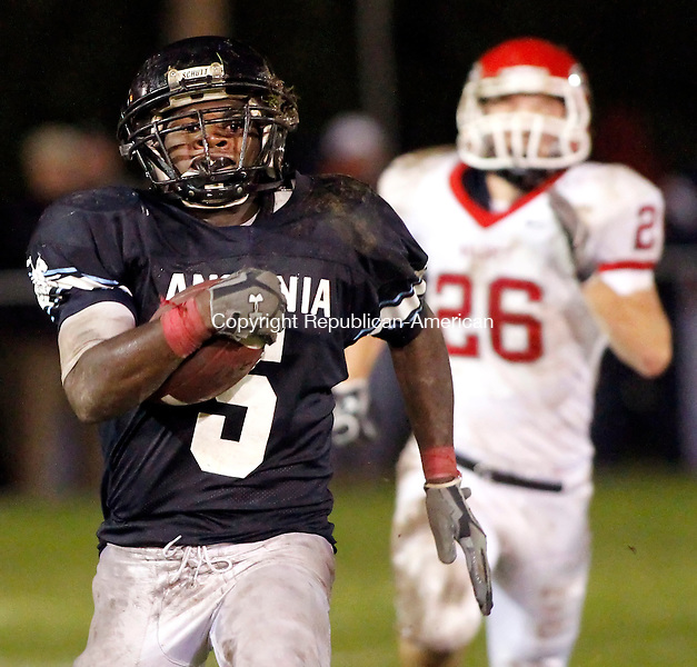 Ansonia, CT- 15, October 2010-101510CM11 Ansonia's Montrell Dobbs carries the ball in for a touchdown Friday night in Ansonia.  Trailing behind is Wolcott defender, Zach Zavednak. Chargers went onto win, 39-20.  Christopher Massa Republican-American