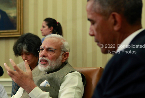 Prime Minister Narendra Modi of India makes remarks to the media as United States President Barack Obama listens in the Oval Office of the White House in Washington, DC on June 7, 2016.  During their meeting the leaders discussed a number of topics including cybersecurity, climate change, and economic cooperation.<br /> Credit: Dennis Brack / Pool via CNP
