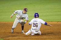 Texas A&M Aggies shortstop Blake Allemand (1) tags LSU Tigers baserunner Chris Chinea (26) out during steal attempt in the Southeastern Conference baseball game on April 23, 2015 at Alex Box Stadium in Baton Rouge, Louisiana. LSU defeated Texas A&M 4-3. (Andrew Woolley/Four Seam Images)