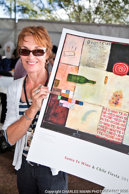 The 2011 Santa Fe Wine & Chile Fiesta brought together local Santa Fe restaurants and wineries from all over the country to serve hundreds of visitors who sampled wine and food under ideal September skies. Artist Melinda K Hall holds the poster she designe for the Fiesta.