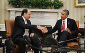 Prime Minister Nouri Al-Maliki of Iraq, left, shakes hands with United States President Barack Obama in the Oval Office at the White House, Friday, November 1, 2013 in Washington, DC.<br /> Credit: Olivier Douliery / Pool via CNP