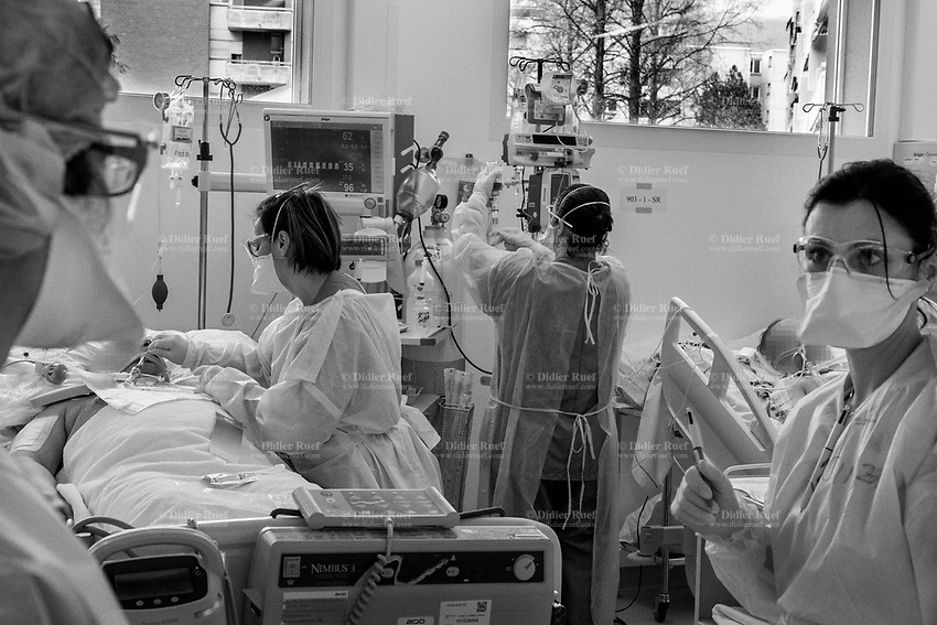 Switzerland. Canton Ticino. Lugano. Due to the spread of the coronavirus (also called Covid-19) and given the increase in cases in Ticino, the Clinica Luganese Moncucco was transformed into a Covid-19 Hospital. Nurses working at intensive care unit (ICU). The patients are all in severe conditions and cannot breathe on their own. They all require intubation and the use of a ventilator. Intubation is the process of inserting a breathing tube through the mouth and into the airway. A ventilator—also known as a respirator or breathing machine—is a medical device that provides oxygen through the breathing tube. For patients critically ill with Covid-19, access to a ventilator is a matter of life or death. The machines get oxygen into the lungs and remove carbon dioxide from the body. The ventilators need to not only keep people breathing but also accurately monitor their lungs, using a mix of airflow, temperature, humidity and pressure sensors. ICU ventilators use touchscreens to provide a range of tools to assess the appropriate respiratory therapy. All nurses are dressed in protective clothing that seal them off the contaminated environment. They all wear FFP2 masks, latex medical gloves, protective glasses and yellow plastic aprons above their medical green clothes. The single-use mask protects against solid and liquid particles. The Safemask Premimum offers respiratory protection to medical staff. Medical gloves are disposable gloves used during medical examinations and procedures to help prevent cross-contamination between caregivers and patients. In the fight against the coronavirus, nurses play a critical role, but some on the front lines in the hardest-hit areas fear for their health. 25.03.2020 © 2020 Didier Ruef