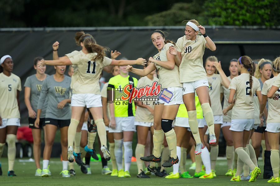 Claudia Day (18) and Sarah Medina (30) of the Wake Forest Demon Deacons body slam prior to their match against the UCLA Bruins at Spry Soccer Stadium on September 11, 2015 in Winston-Salem, North Carolina.  The Bruins defeated the Demon Deacons 2-1.  (Brian Westerholt/Sports On Film)