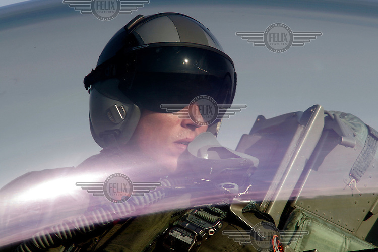 Lockheed Martin F-16 Fighting Falcon performs a display during Rygge Airshow. Pilot in cockpit. Norway