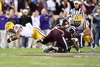 LSU running back Terrence Magee (18) dives for a first down during an NCAA football game, Thursday, November 27, 2014 in College Station, Tex. (Mo Khursheed/TFV Media via AP Images)