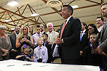 Surrounded by state lawmakers and the families of students who were victims of bullying, Nevada Gov. Brian Sandoval signs an anti-bullying bill into law at Carson Middle School in Carson City, Nev., on Wednesday, May 20, 2015.<br /> Photo by Cathleen Allison