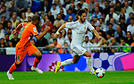 Isco Alarcon vies with Feghouli during the Spanish league football match Real Madrid CF vs Valencia CF at the Santiago Bernabeu stadium in Madrid on May 4, 2014. PHOTOCALL3000/