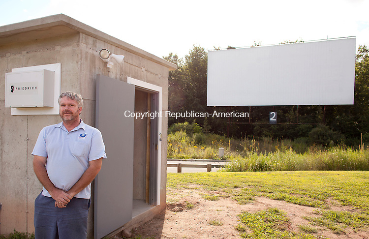 SOUTHINGTON, CT-14 August 2013-081413BF01-  Ron Newman, a member of the Southington Drive-In Committee in Southington, stands outside the projection booth of the restored drive-in. Drive-in movie theaters across the country will face closure by the end of the year due to a push to digital projection systems. The Southington Drive-In already has digital projection for it's summer movie showings. Bob Falcetti Republican-American
