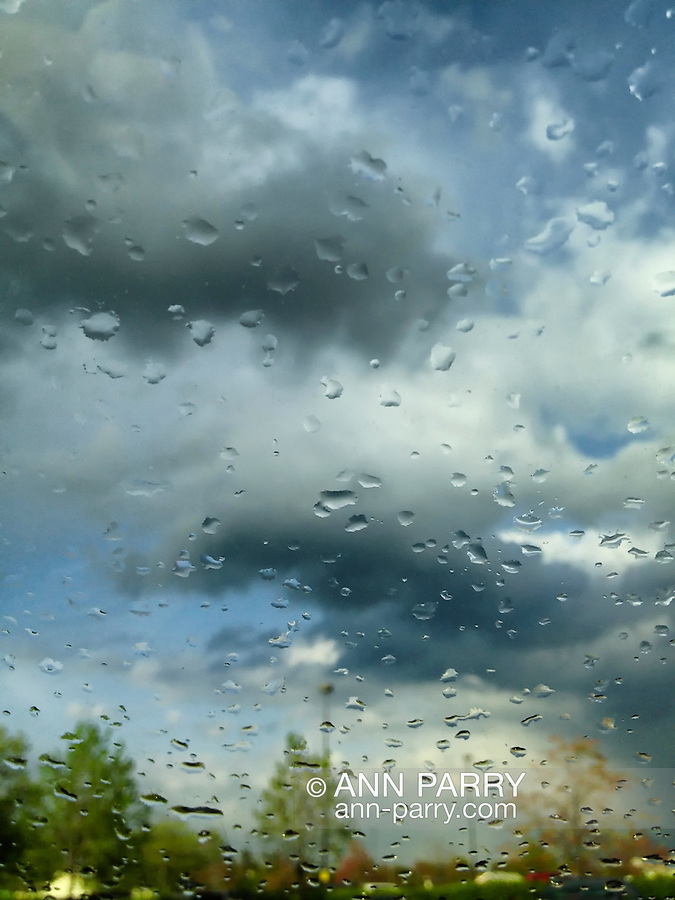 rainy windshield in parking lot, Westbury, New York, USA, April 25, 2012 - photo taken with iPhone 4S