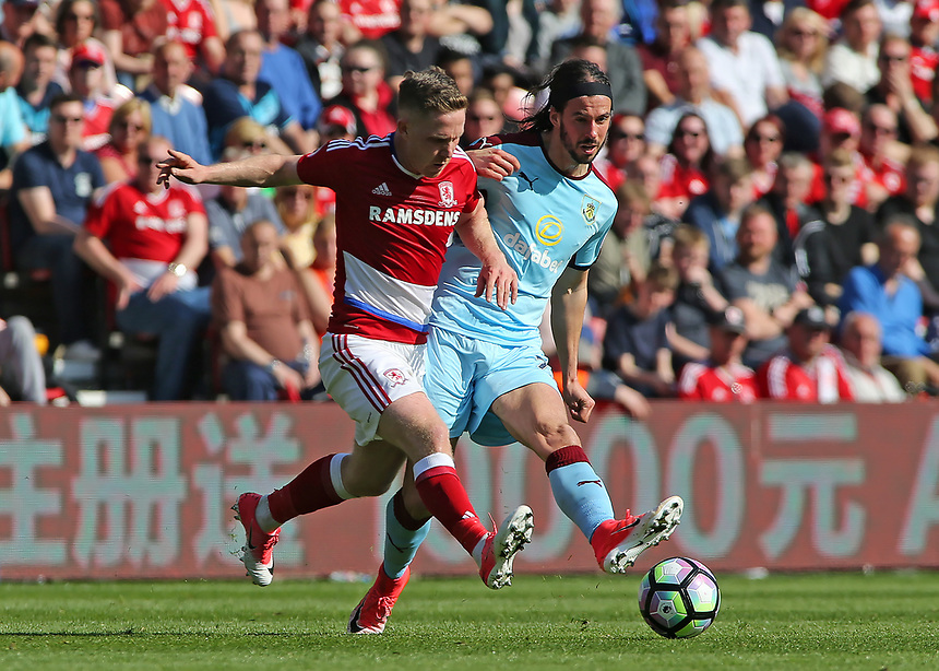 Middlesbrough's Adam Clayton battles with Burnley's George Boyd<br /> <br /> Photographer David Shipman/CameraSport<br /> <br /> The Premier League - Middlesbrough v Burnley - Saturday 8th April 2017 - Riverside Stadium - Middlesbrough<br /> <br /> World Copyright &copy; 2017 CameraSport. All rights reserved. 43 Linden Ave. Countesthorpe. Leicester. England. LE8 5PG - Tel: +44 (0) 116 277 4147 - admin@camerasport.com - www.camerasport.com