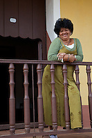 Cuba, Trinidad.  Woman on Front Porch.