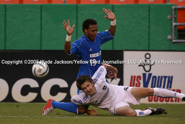 28 May 2005, Danny Califf (4) of the Earthquakes goes down after a challenge from Scott Sealy (19) of the Wizards.  The MLS Kansas City Wizards shut out the Earthquakes by a score of 1-0 in a hard fought regular season MLS match at Arrowhead Stadium, Kansas City, Missouri.  .. ..