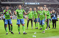 LOS ANGELES, CA - OCTOBER 29: Kelvin Leerdam #18, Roman Torres #29 and Raul Ruidiaz #9 and the Seattle Sounders FC celebrate their MLS Western Conference victory over Los Angeles FC during a game between Seattle Sounders FC and Los Angeles FC at Banc of California Stadium on October 29, 2019 in Los Angeles, California.