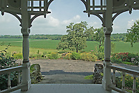 The front porch of a farm house looks across bottom land on a farm near West Liberty, Ohio.