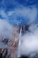 793050049 a dc-3 with ecotourists flies over angel falls in canaima national park in the lost world in venezuela