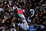 Mourners carry the body of Palestinian Osama Abu Khater, who died of wounds he sustained during clashes with Israeli troops, his funeral in Khan Younis in the southern Gaza Strip on June 24, 2018. Photo by Ashraf Amra