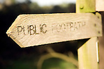 Public footpath wooden direction sign, Suffolk, England