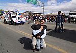 Devlin Folds, 6, ran from the sidelines of the Nevada Day parade to hug gubernatorial candiate Brian Sandoval on Saturday in Carson City. Kathleen Sandoval and daughter Maddy, 13, are at right.  .Photo by Cathleen Allison