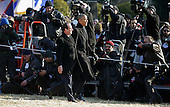 United States President Barack Obama and French President Francois Hollande walk past a crowd of photographers during an official State Visit on the South Lawn of the White House February 11, 2014 in Washington, DC. The two leaders will hold bilateral meetings, a joint press conference and attend an official State Dinner later in the day.  <br /> Credit: Chip Somodevilla / Pool via CNP