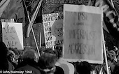 "Placards, including one showing Harold Wilson, the British Prime Minister at the time, at the anti-Vietnam war demonstration march from Trafalgar Sq to Grosvenor Sq Sunday 17th March 1968.  The Vietcong flag is held aloft.  A banner says ""Victory to the NLF"".  The Vietcong (National Liberation Army, NLF) was a political organisation and guerrilla army in South Vietnam which fought the Americans."