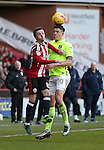 Stefan Scougall of Sheffield Utd and Alex Revell of Northampton during the English League One match at Bramall Lane Stadium, Sheffield. Picture date: December 31st, 2016. Pic Simon Bellis/Sportimage
