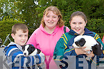 Evan, Marguerite and Cheala Murphy Gneeveguilla admiring the puppies at Rathmore Fair on Sunday.