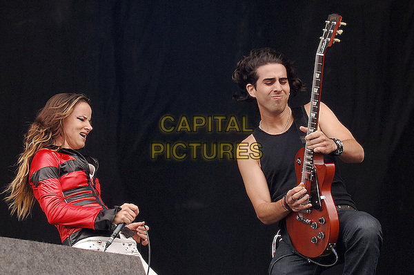 JULIETTE LEWIS & THE LICKS.Performing live at the V Festival, Hylands Park, Chelmsford, England..August 18th, 2007.stage concert live gig performance music half length red black leather jacket singing guitar.CAP/BEL.©Belcher/Capital Pictures