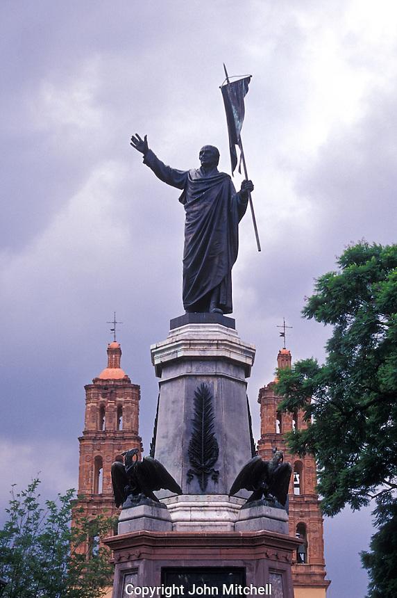 Statue of Miguel Hidalgo in the main square of Dolores Hidalgo, Mexico. The Parroquia de Nuestra Senora de Dolores is in the background.