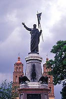 Statue of Miguel Hidalgo in the main square of Dolores Hidalgo, Mexico. The Parroquia de Nuestra Senora de Dolores is in the background.