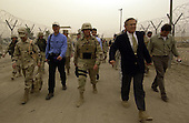 United States Secretary of Defense Donald H. Rumsfeld takes a tour of the Abu Ghraib Detention Center in Abu Ghraib, Iraq, on May 13, 2004.  Rumsfeld and Chairman of the Joint Chiefs of Staff General  Richard B. Myers are in Iraq to visit the troops in Baghdad and Abu Ghraib.   <br /> Mandatory Credit: Jerry Morrison / DoD via CNP